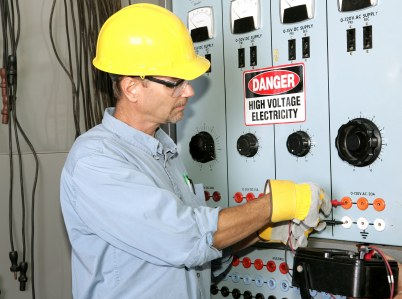 Ingram Electric Company industrial electrician working with high voltage.